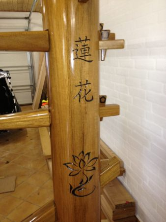 Lotos engraving on a custom made wooden dummy